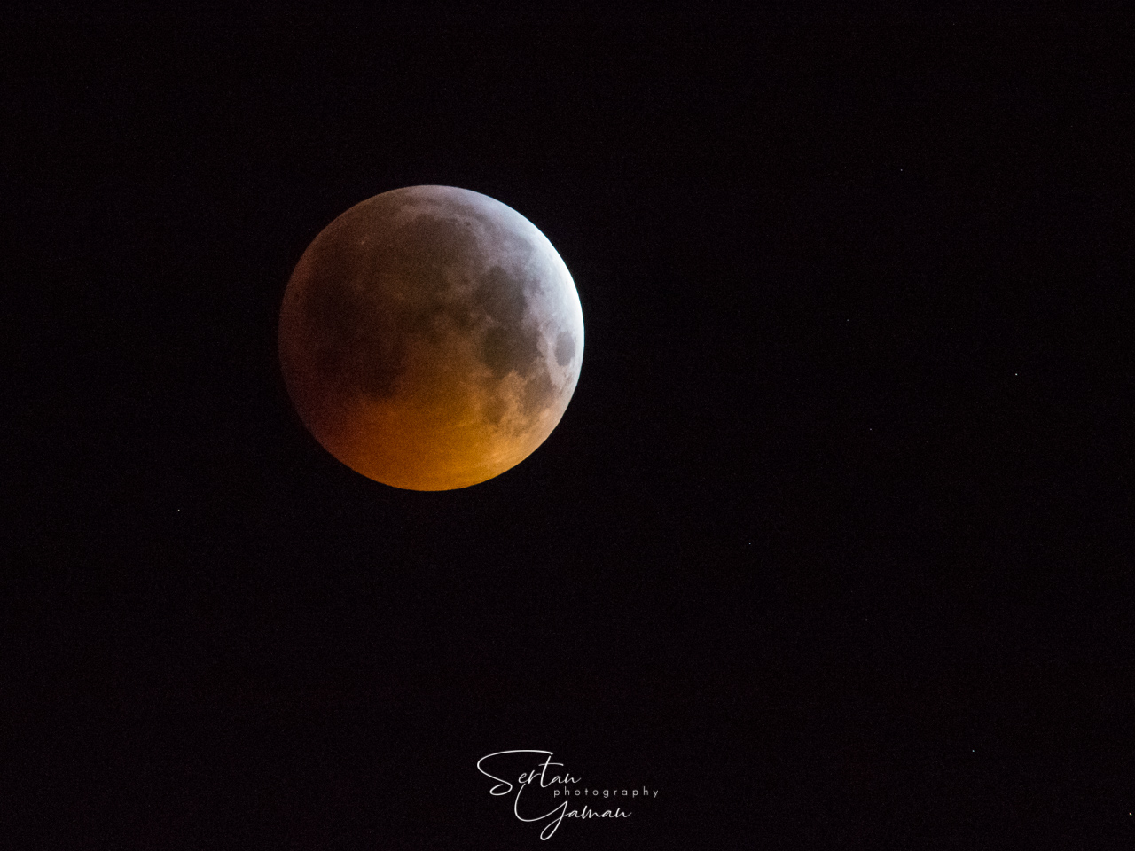 Amsterdam, The Netherlands - January 21, 2019: Super blood wolf moon, moon eclipse on sky